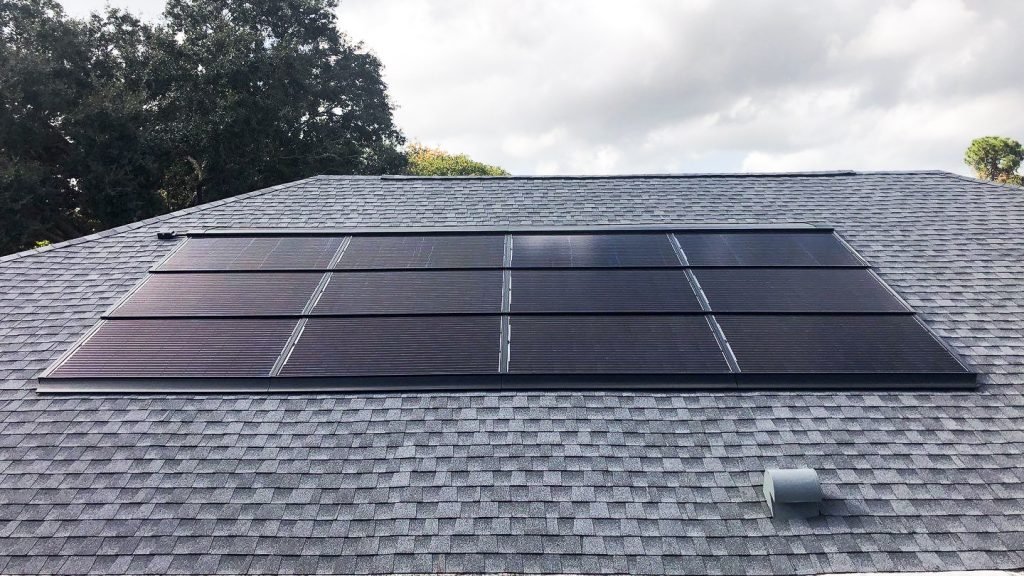 Solar panels flashed to roof