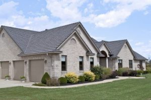 Residential gray home with roof